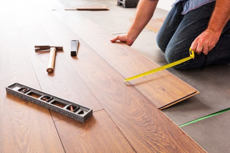 man installing wooden flooring