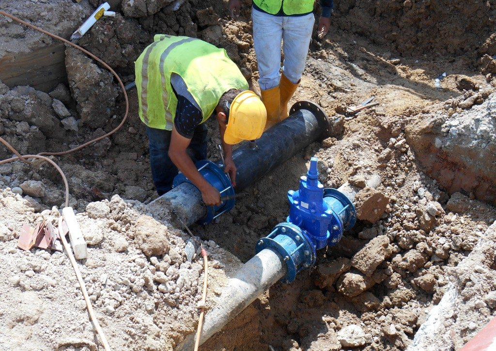 Workers changing sewer pipes