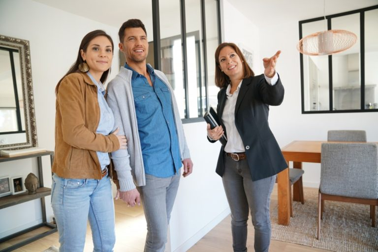Real estate agent touring the couple around the house