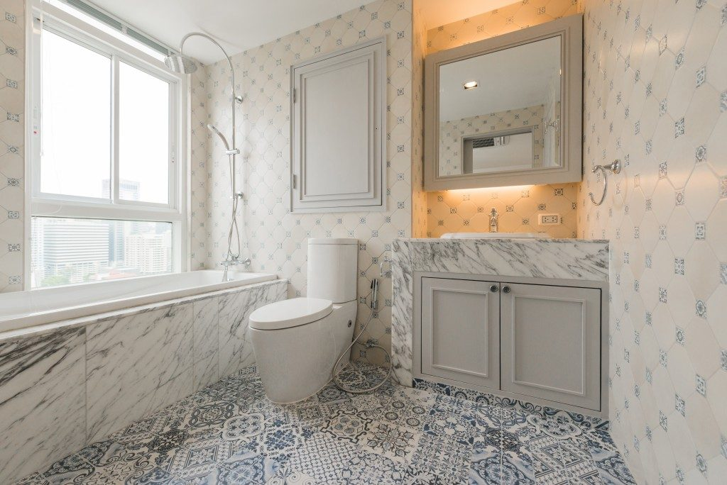 bathroom with bathtub in marble countertop