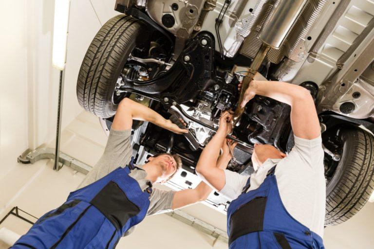 maintenance guys fixing a car