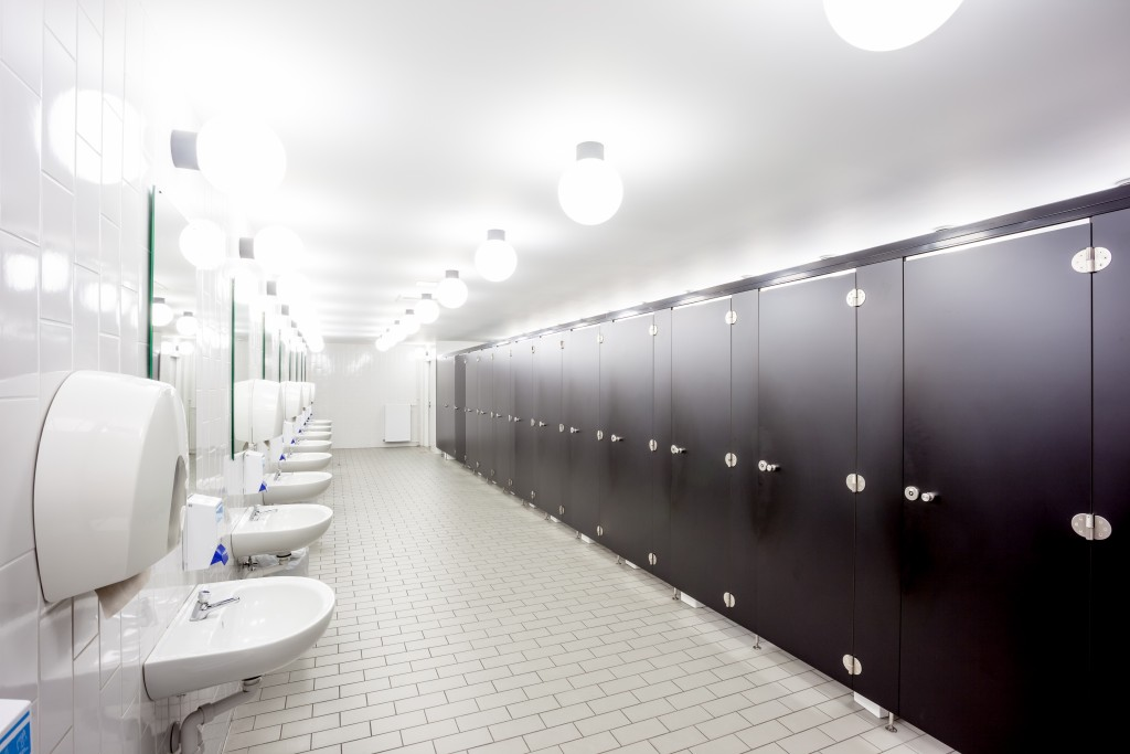 wide office washroom in white and brown color interior