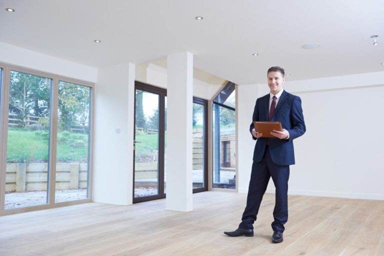 Property manager standing inside house