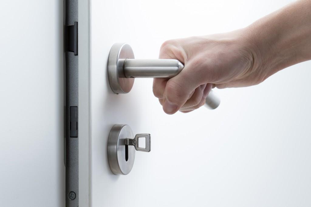 a hand opening a doorknob