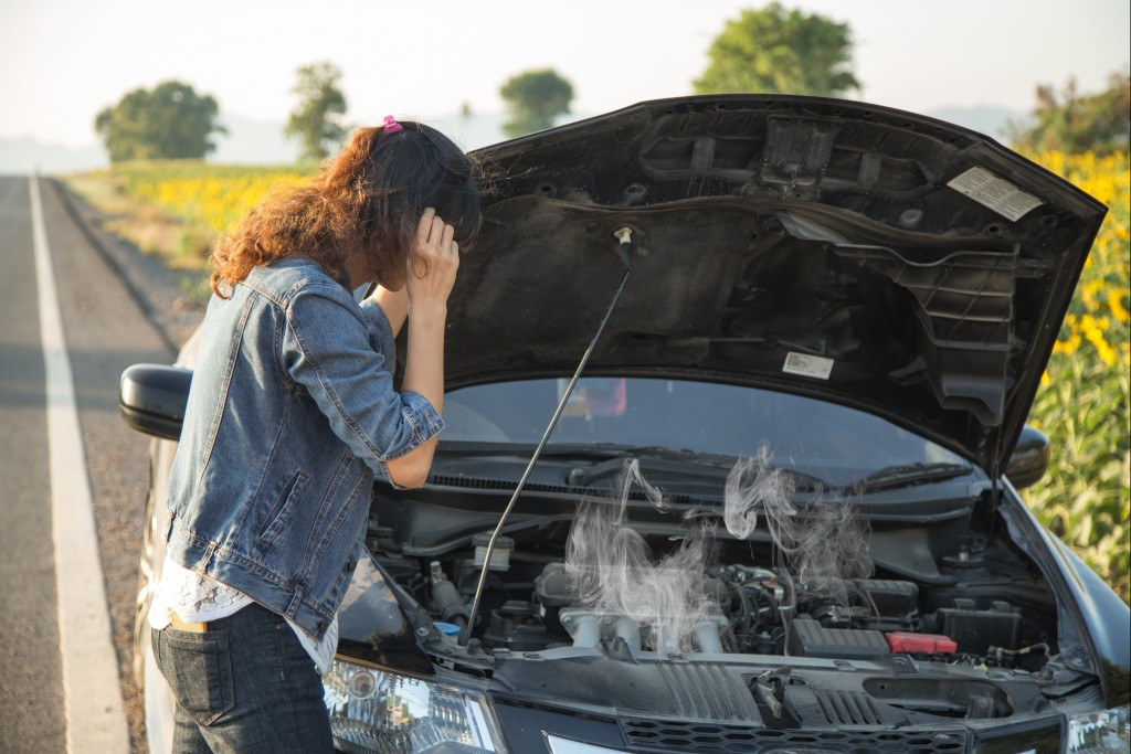 woman with an overheated car