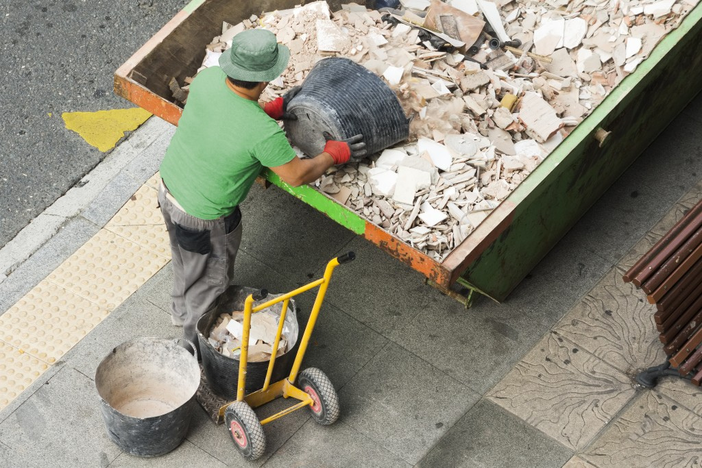 man collecting debris