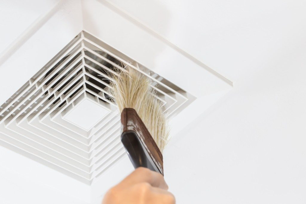 Man cleaning air ventilation