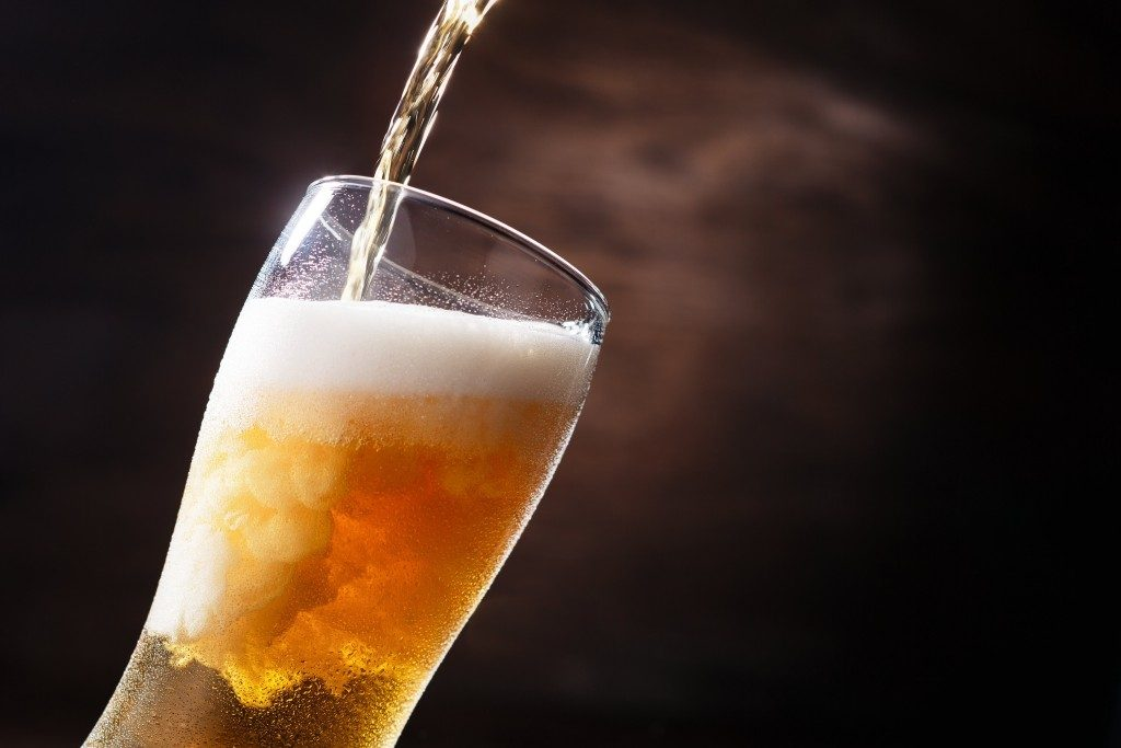 Close up of beer being poured in a glass