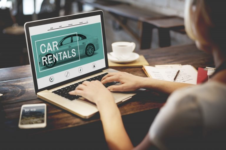Woman looking up car rentals