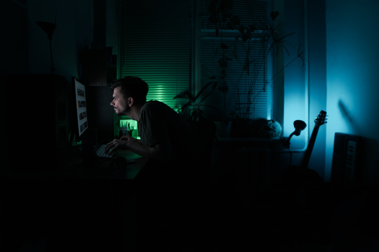 Man working in the dark