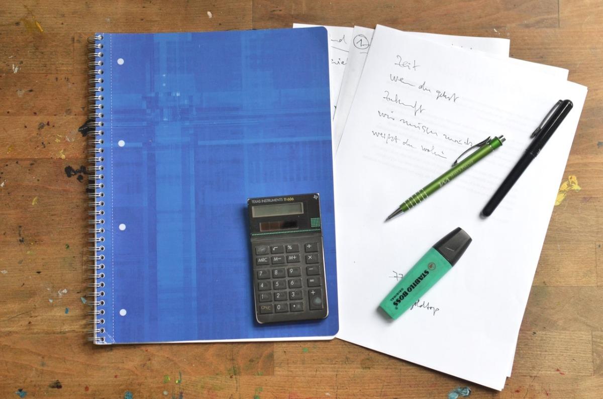 calculator and pens